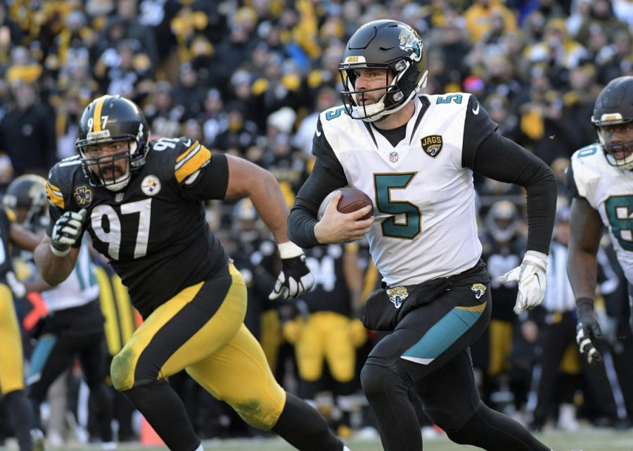 Jacksonville+Jaguars+quarterback+Blake+Bortles+%285%29+scrambles+out+of+the+pocket+during+the+second+half+of+an+NFL+divisional+football+AFC+playoff+game+in+Pittsburgh%2C+Sunday%2C+Jan.+14%2C+2018.+%28AP+Photo%2FDon+Wright%29