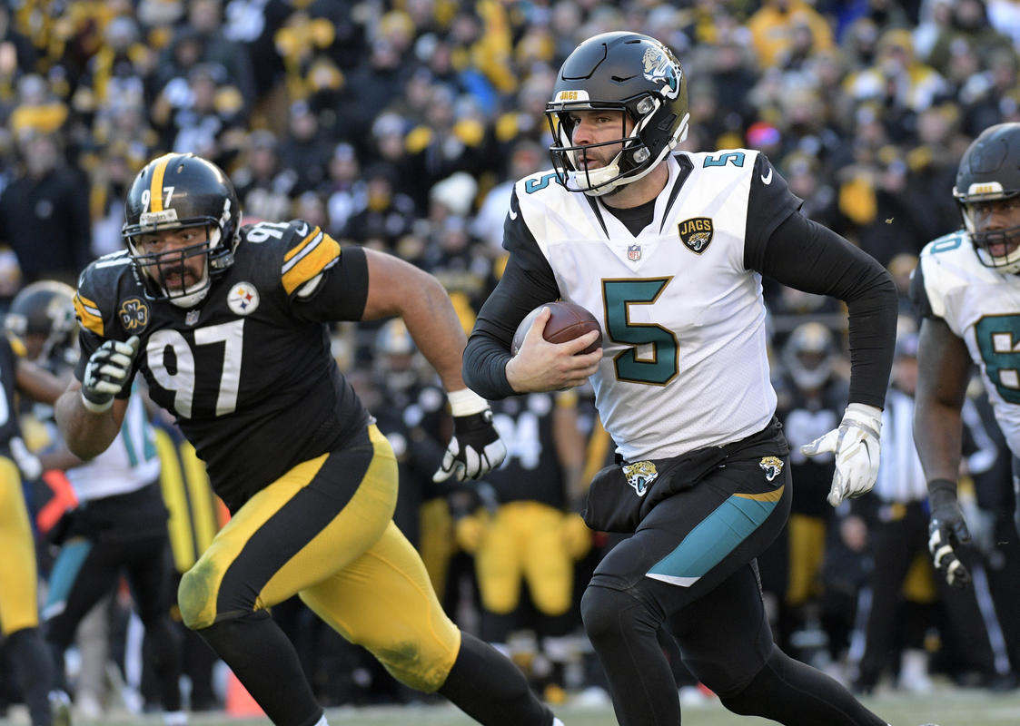 Jacksonville Jaguars quarterback Blake Bortles (5) scrambles out of the pocket during the second half of an NFL divisional football AFC playoff game in Pittsburgh, Sunday, Jan. 14, 2018. (AP Photo/Don Wright)